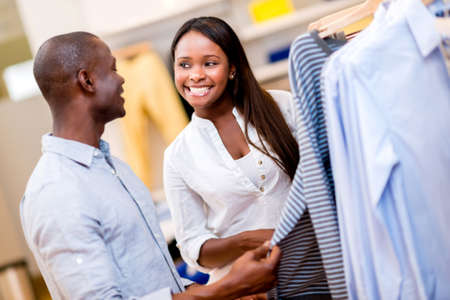 Happy couple shopping clothes at a retail store Stock Photo