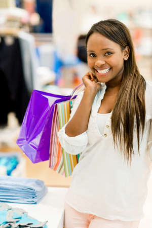 Happy shopping woman holding bags and looking beautiful photo