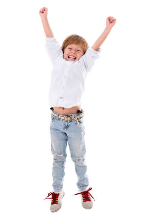 Happy boy with arms up - isolated over a white background photo