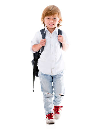 Happy boy walking to school - isolated over a white background