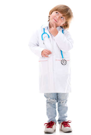 Pensive boy dressed as a doctor - isolated over white background Stock Photo