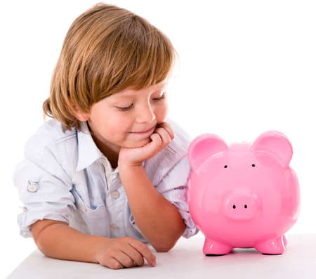 Happy boy with savings in a piggybank - isolated over a white background Stock Photo