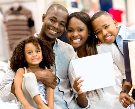 Happy family with a open open banner at a store photo