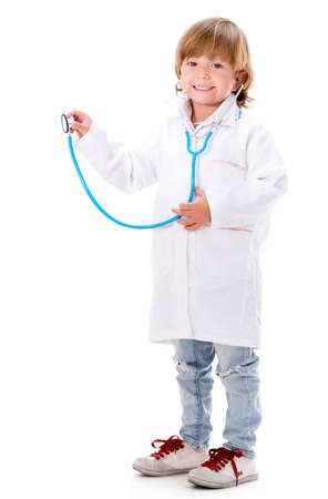 Happy boy playing a doctor holding a sthetoscope - isolated over white photo