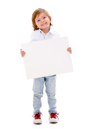 Happy boy holding a banner and smiling - isolated over a white background photo