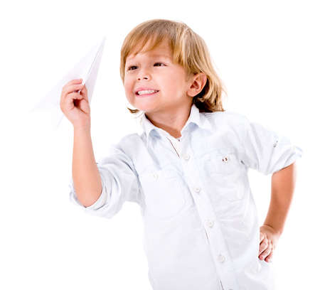 Happy boy playing with a paper plane - isolated over white background photo