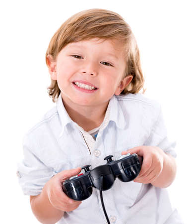 Happy boy playing videogames - isolated over a white background photo
