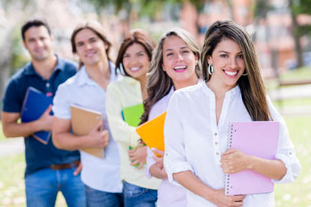 Casual group of students looking very happy outdoors