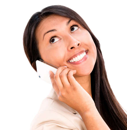 Happy woman talking on the phone - isolated over white background photo
