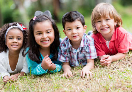 hispanic children: Happy group of kids playing at the park Stock Photo