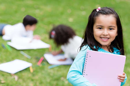 Beautiful school girl looking very happy outdoors Stock Photo