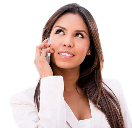 Business woman talking on the phone - isolated over a white background photo