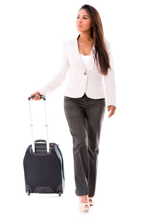 Successful woman going on a business trip - isolated over white background Stock Photo - 21776930