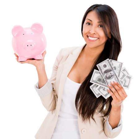 Woman saving money in a piggybank - isolated over white background Stock Photo