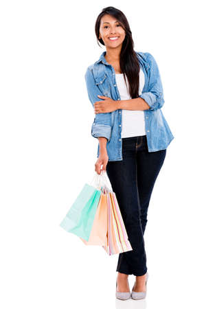Happy shopping woman holding bags - isolated over a white background Stock Photo - 21776951