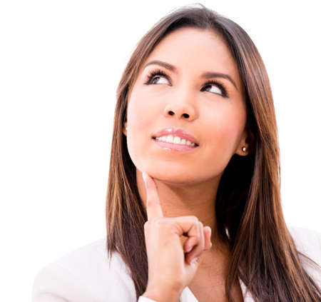 Thoughtful business woman smiling - isolated over a white background photo