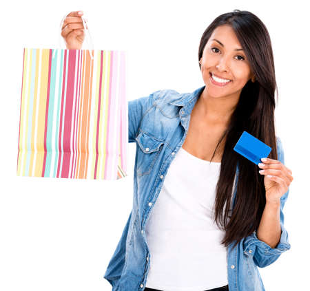 debit: Happy female shopper with a credit card - isolated over a white background Stock Photo