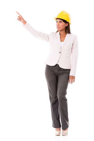 Female architect pointing away - isolated over a white background photo