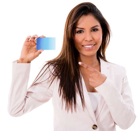 Happy business woman with a credit card- isolated over white background photo