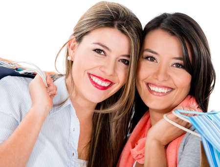 Happy female shoppers smiling - isolated over a white background Stock Photo - 22012638