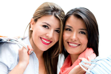 Happy female shoppers smiling - isolated over white Stock Photo - 22012639