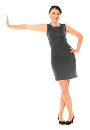 Business woman leaning imaginary wall - isolated over white photo