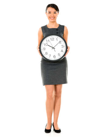 Happy business woman holding a clock - isolated over white photo