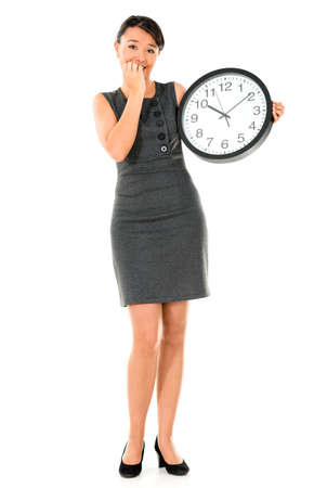 Business woman running late - isolated over a white background photo