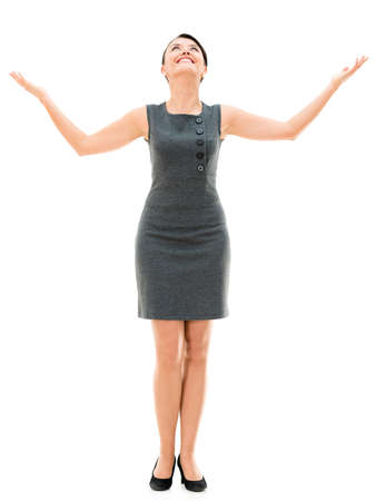 woman looking up: Business woman with arms open looking up - isolated over white