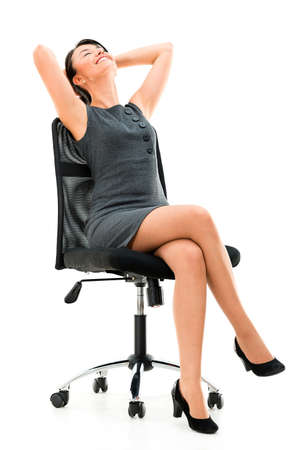 comfortable chair: Business woman sitting in a comfortable chair - isolated over white