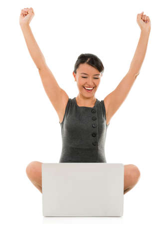Business woman celebrating her online success - isolated over white Stock Photo - 22143809