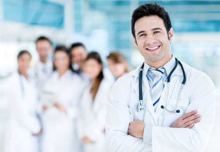 medical physician: Happy doctor with medical staff at the hospital