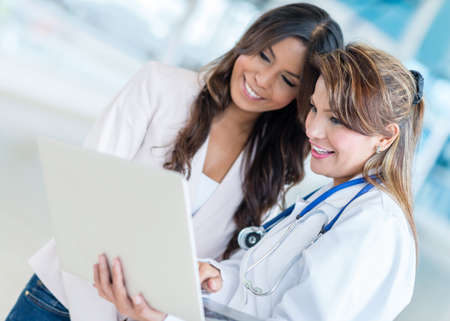 promoting: Corporate woman at the hospital promoting medical insurance
