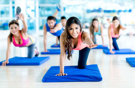 class: Group of people at the gym in a stretching class Stock Photo