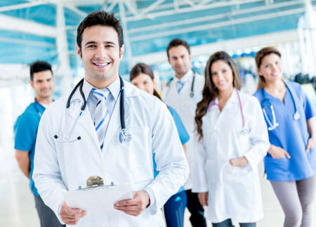 medical staff: Male doctor with a medical group at the hospital Stock Photo