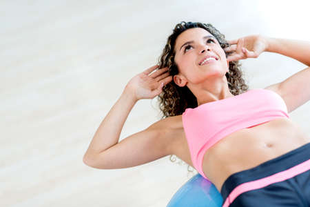 sixpack: Gym woman doing crunches on a Pilates ball