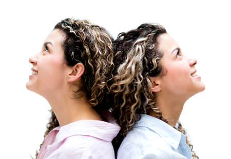 Portrait of a couple of female twins - isolated over a white background photo