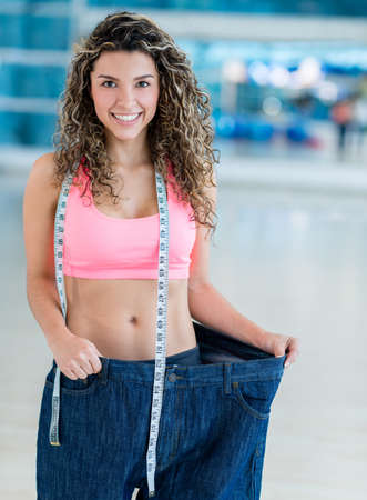 baggy: Fit woman in baggy pants after loosing weight