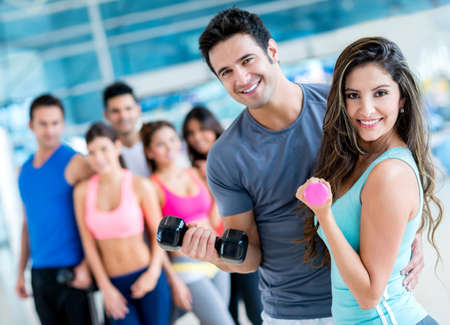gym class: Group of people at the gym looking very happy Stock Photo