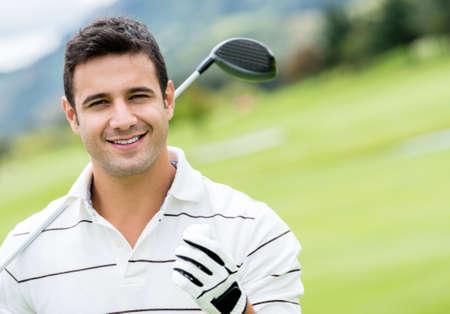 Handsome man Golf spielen und suchen glücklich Lizenzfreie Bilder
