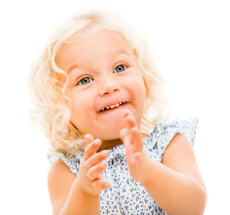 Happy little girl clapping - isolated over a white background photo