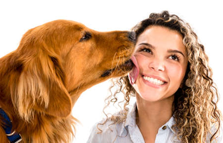 Cute dog licking womans face - isolated over white background photo
