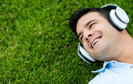 Man listening to music outdoors with headphones photo