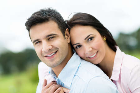 hugging couple: Beautiful portrait of a loving couple looking happy outdoors