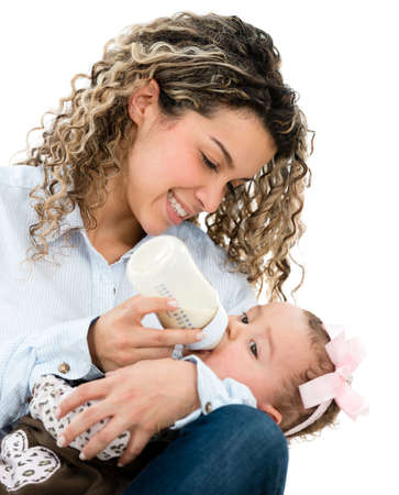 Mother feeding her baby from a bottle - isolated over white photo