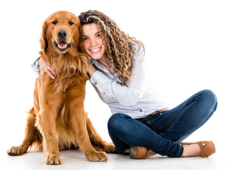 golden retriever: Happy woman with a beautiful dog - isolated over white background