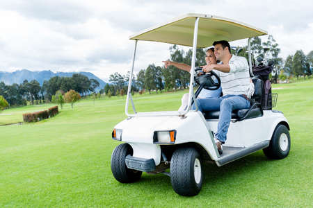 Group of players in a golf cart at the course photo
