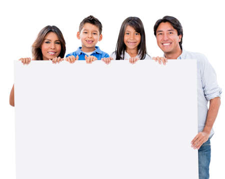 Happy family with a banner ad - isolated over white background photo