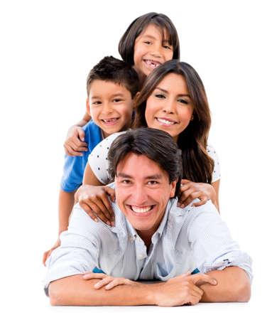 Happy family portrait auf dem Boden liegend - über einen weißen Hintergrund isoliert Lizenzfreie Bilder