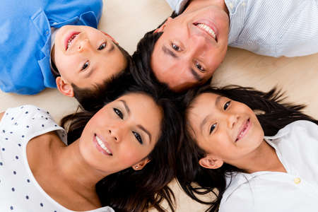 Beautiful portrait of a hispanic family with heads together photo